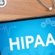 Ipad on desk with HIPAA logo on screen