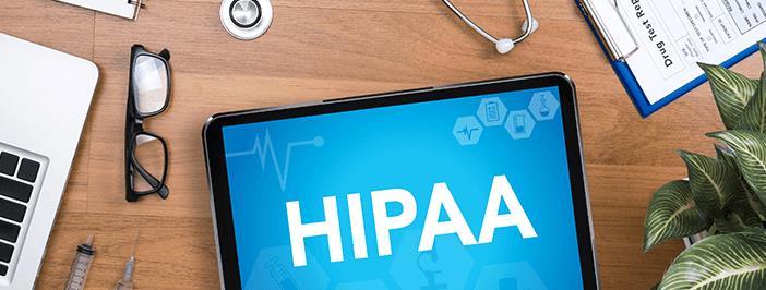 Ipad on desk with HIPAA logo on screen
